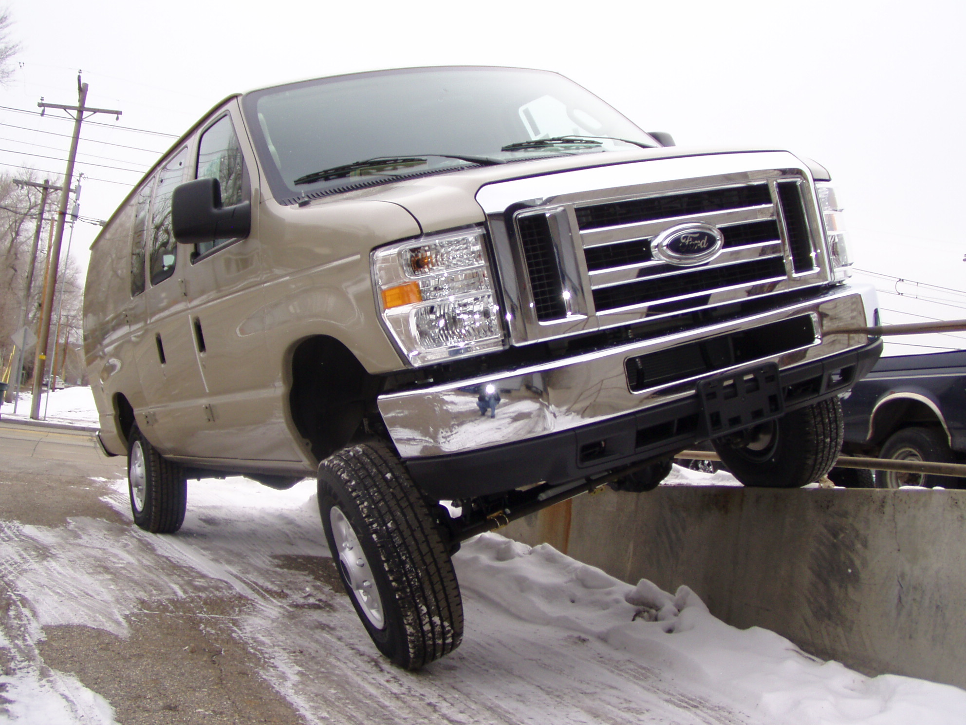 Ford 4x4 Van Driving On Curb
